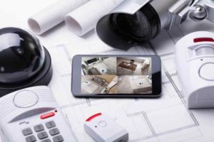 mobile phone showing cctv surveillance on table with security equipment (1)