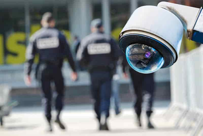 two guards patrolling perimeter with cctv 360 camera in focus